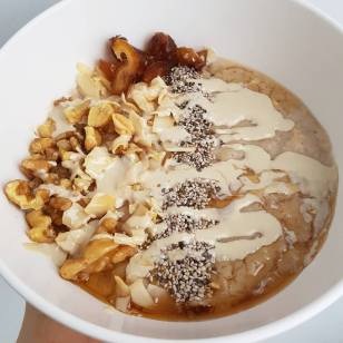 Warm oats with nuts and tahini