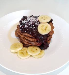 Chocolate Oats Pancakes with berries and bananas